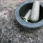 A broken pestle with mortar