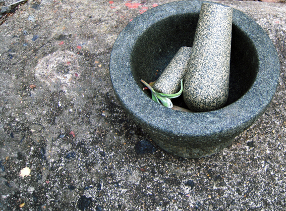 A broken pestle with mortar