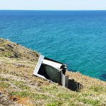 Dead television on a cliff