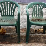 Two more dead stacking chairs